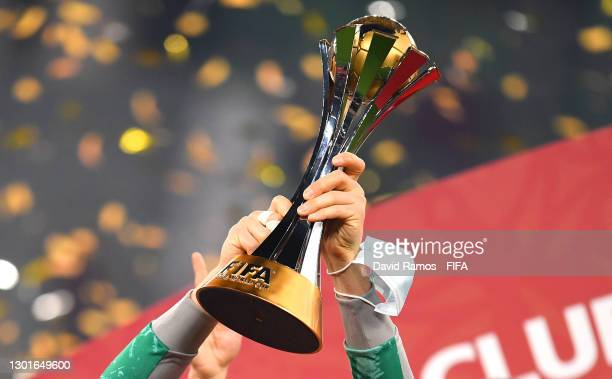 Detailed view of the FIFA Club World Cup Qatar 2020 trophy lifted by Manuel Neuer of FC Bayern Muenchen as FC Bayern Muenchen celebrate after winning...