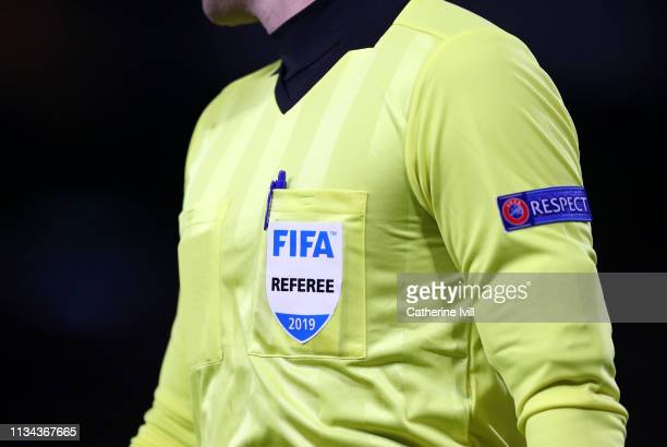 Detailed view of the FIFA referee badge during the UEFA Europa League Round of 16 First Leg match between Chelsea and Dynamo Kyiv at Stamford Bridge...