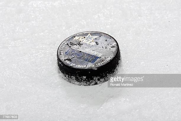 A detailed view of the game puck on the ice for the NHL game between the Los Angeles Kings and the Dallas Stars at the American Airlines Center on...