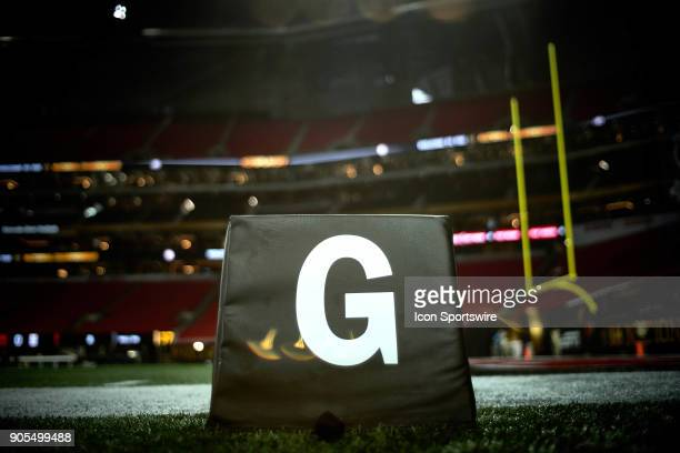 A detailed view of the goal line field marker is seen during the CFP National Championship presented by ATT between the Georgia Bulldogs and the...