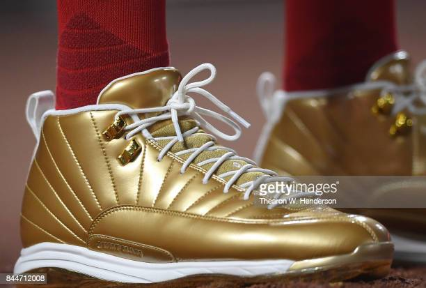 A detailed view of the gold Nike Air Jordans XII's baseball cleats worn by Dexter Fowler of the St Louis Cardinals against the San Francisco Giants...