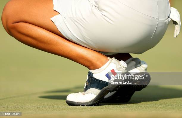 A detailed view of the golf shoes worn by Celine Boutier of France during the third round of the US Women's Open Championship at the Country Club of...
