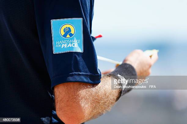 A detailed view of the Handshake for Peace logo on te shirt of a match official during the Group A FIFA Beach Soccer World Cup match between...