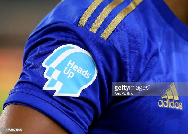 A detailed view of the 'Heads Up Campaign' tshirt on Youri Tielemans of Leicester City during the Premier League match between Wolverhampton...