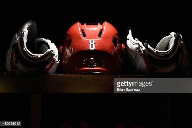 A detailed view of the helmet and gloves of Alexander Ovechkin of the Washington Capitals in the locker room stall during the 2015 Bridgestone NHL...