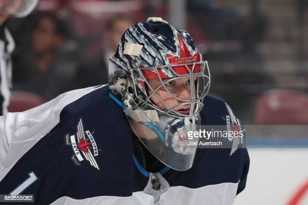 A detailed view of the helmet of goaltender Eric Comrie of the Winnipeg Jets as he looks up ice during first period action against the Florida...