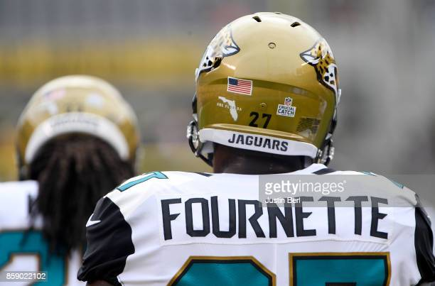 A detailed view of the helmet worn by Leonard Fournette of the Jacksonville Jaguars with One Florida and Crucial Catch stickers before the game...