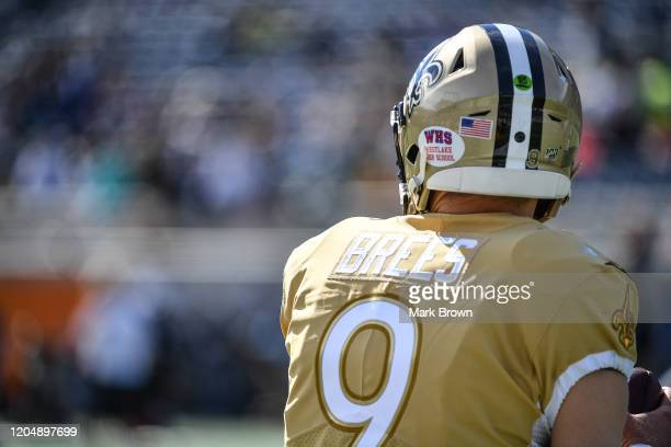 A detailed view of the high school decal on the helmet of Drew Brees of the New Orleans Saints warming up prior to the 2020 NFL Pro Bowl at Camping...