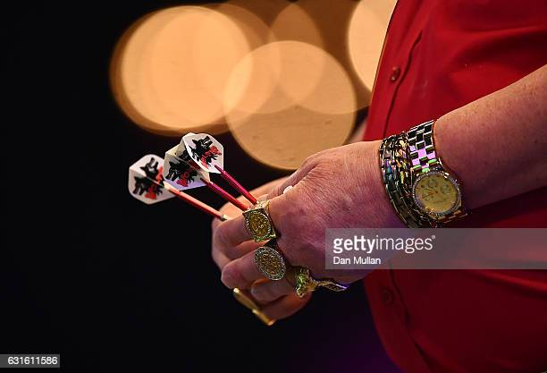 A detailed view of the jewellery of Martin Adams of England during his Mens Quarter Final match against Jamie Hughes of England on day seven of the...