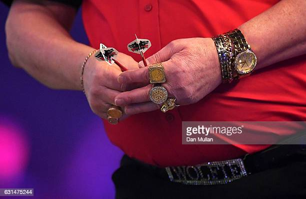 A detailed view of the jewllery of Martin Adams of England during his Mens' second round match against Jeff Smith of Canada on Day Five of the BDO...