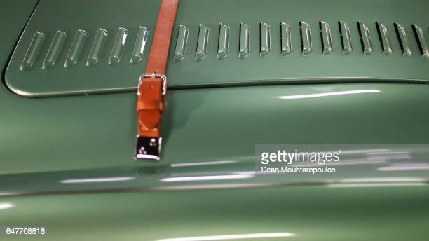 A detailed view of the leather belt strap on the hood or bonnet on a Austin Healey 100M during the The 40th Antwerp Classic Salon run by SIHA Salons...
