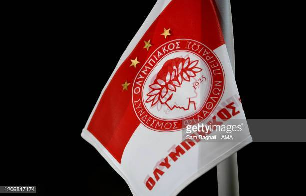 A detailed view of the logo on a corner flag of Olympiacos FC during the UEFA Europa League round of 16 first leg match between Olympiacos FC and...