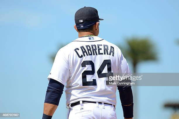 A detailed view of the MLB logos displayed on the jersey and hat of Miguel Cabrera of the Detroit Tigers during the Spring Training game against the...