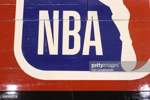 A detailed view of the NBA logo painted on the wooden floor boards of the court prior to the start of the Toronto Raptors NBA game against the Dallas...