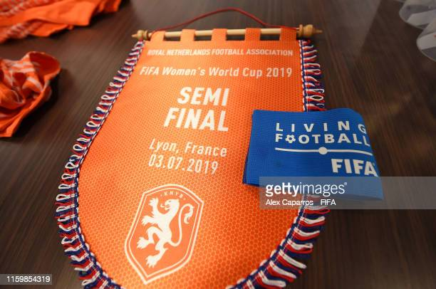 Detailed view of the Netherlands pennant is seen alongside the captains armband inside the dressing room prior to the 2019 FIFA Women's World Cup...
