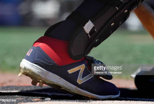 A detailed view of the New Balance baseball cleats worn by Carlos Santana of the Cleveland Indians while he looks on from the ondeck circle against...