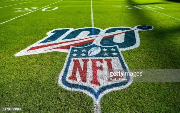 A detailed view of the NFL 100 logo on the field prior to the game between the Miami Dolphins and the Baltimore Ravens at Hard Rock Stadium on...