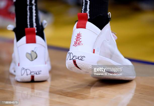 """Detailed view of the Nike Air Jordan's with a heart and the name """"Deuce' on the back worn by Jayson Tatum of the Boston Celtics against the Golden..."""