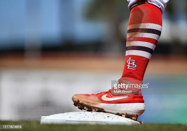 A detailed view of the Nike cleat worn by Kolten Wong of the St Louis Cardinals in action during the spring training game against the at Roger Dean...