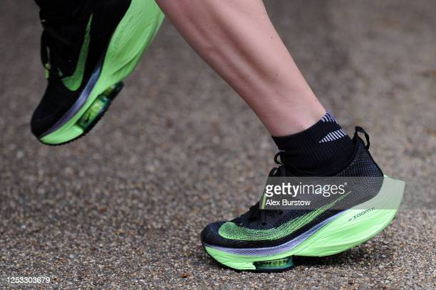 Detailed view of the Nike trainers of British marathon runner Charlotte Purdue as she runs during a training session on June 29, 2020 in East...