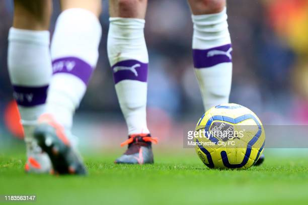 A detailed view of the 'No Room For Racism' branding is seen on the match ball during the Premier League match between Manchester City and Aston...