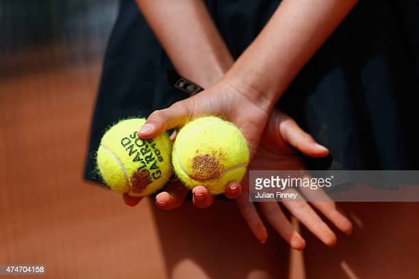 A detailed view of the official balls held by a ball kid on day two of the 2015 French Open at Roland Garros on May 25 2015 in Paris France