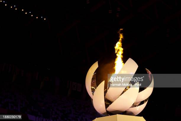 Detailed view of the Olympic cauldron lit during the Opening Ceremony of the Tokyo 2020 Olympic Games at Olympic Stadium on July 23, 2021 in Tokyo,...
