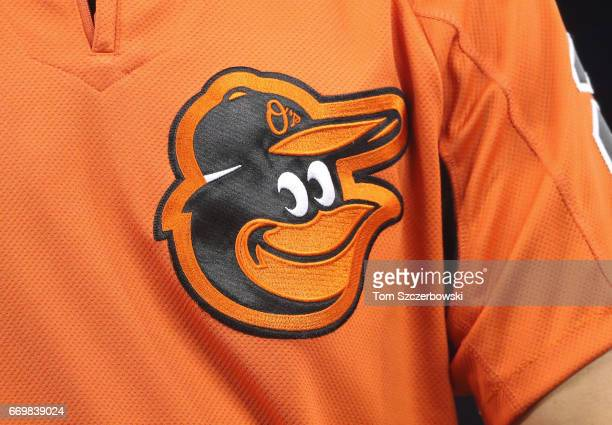 A detailed view of the Orioles logo on the warmup jersey worn by JJ Hardy of the Baltimore Orioles during batting practice before the start of MLB...