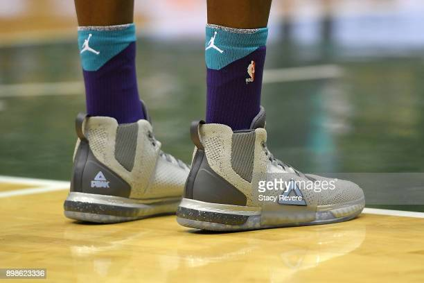 A detailed view of the Peak sneakers worn by Dwight Howard of the Charlotte Hornets during a game against the Milwaukee Bucks at the Bradley Center...