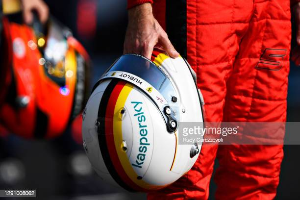 Detailed view of the race helmet of Sebastian Vettel of Germany and Ferrari as he stands on the grid prior to the F1 Grand Prix of Abu Dhabi at Yas...