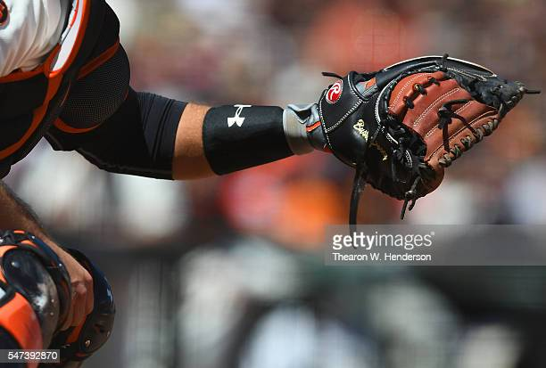 Detailed view of the Rawlings catchers glove worn by Buster Posey of the San Francisco Giants against the Arizona Diamondbacks in the top of the...