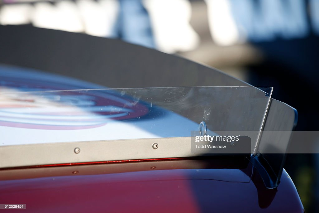 A detailed view of the rear spoiler on the #23 Dr. Pepper Toyota, driven by David Ragan (not pictured), as it sits on pit road during qualifying for the NASCAR Sprint Cup Series Folds of Honor QuikTrip 500 at Atlanta Motor Speedway on February 26, 2016 in Hampton, Georgia.