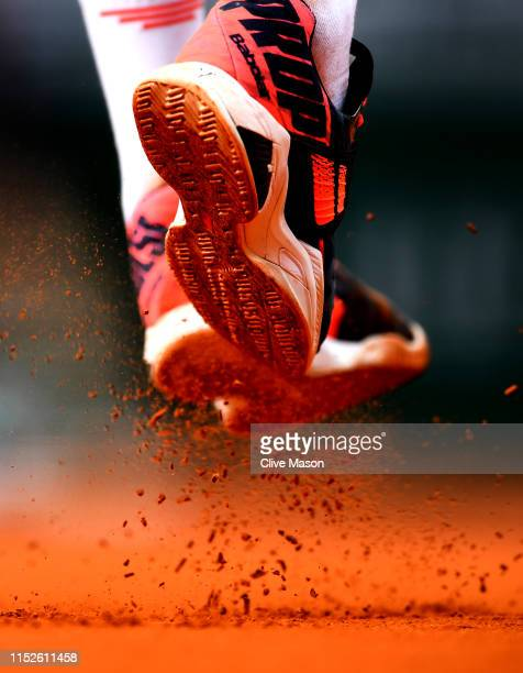 Detailed view of the shoes of Benoit Paire of France as he serves during his mens singles second round match against Pierre-Hugues Herbert of France...