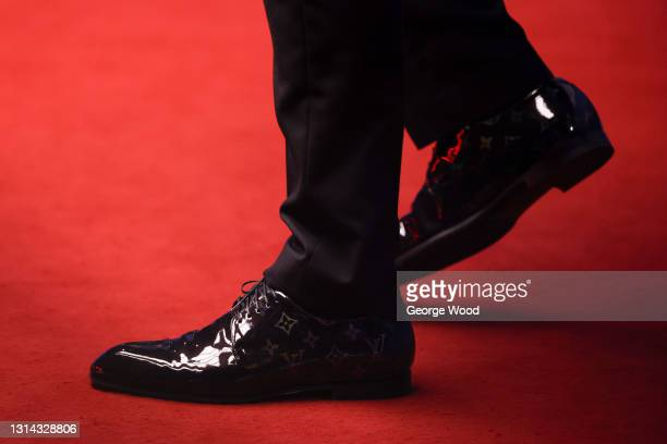 Detailed view of the shoes of Judd Trump of England during the Betfred World Snooker Championship Round Two match between David Gilbert of England...