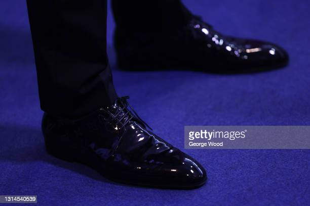 Detailed view of the shoes of Judd Trump of England following the Betfred World Snooker Championship Round Two match between David Gilbert of England...
