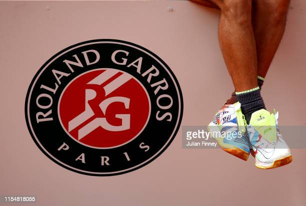 A detailed view of the shoes of Rafael Nadal of Spain as he celebrates victory on the podium following the mens singles final against Dominic Thiem...