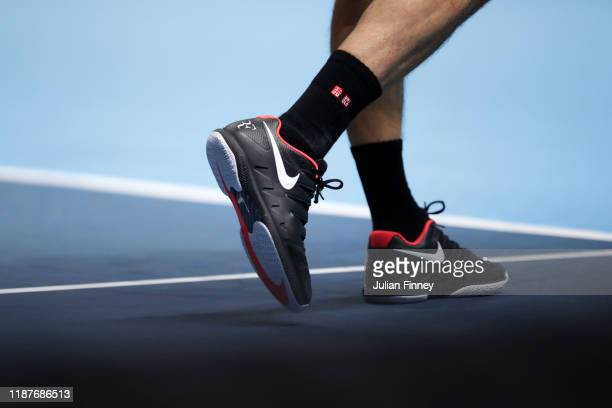 Detailed view of the shoes of Roger Federer of Switzerland during his singles match against Novak Djokovic of Serbia during Day Five of the Nitto ATP...