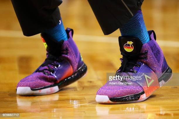 A detailed view of the shoes on Dwight Howard of the Charlotte Hornets looks on before a game against the Boston Celtics at TD Garden on February 28...