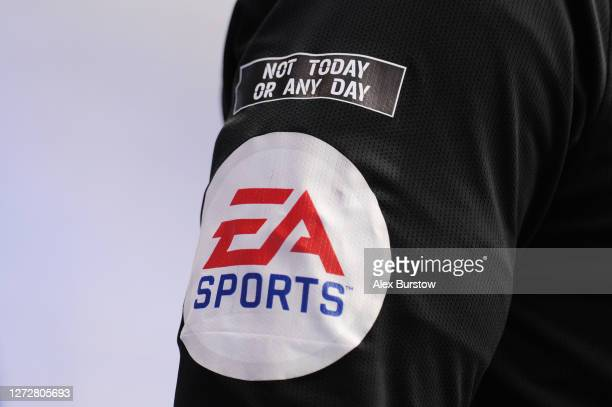 A detailed view of the sleeve of an assistant referee which features a 'Not today or any day' message against racism during the Carabao Cup Second...