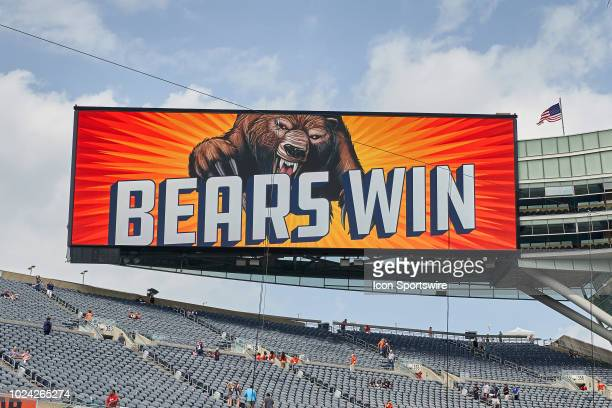 A detailed view of the Soldier Field jumbotron displaying a graphics saying Bears Win after game action in a preseason NFL game between the Kansas...