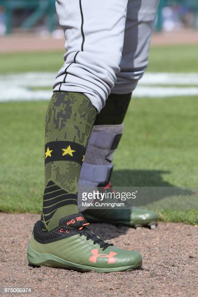 A detailed view of the special shoes and socks worn by Jose Rondon of the Chicago White Sox to honor Memorial Day Weekend during the game against the...