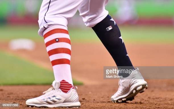 A detailed view of the Stars and Stripes edition Adidas cleats and Stance socks worn by Justin Bour of the Miami Marlins in action against the Tampa...