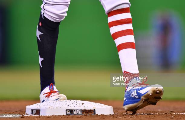 A detailed view of the Stars and Stripes edition Adidas cleats and Stance socks worn by Lewis Brinson of the Miami Marlins during the game against...