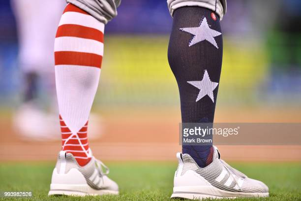 A detailed view of the Stars and Stripes edition Adidas cleats and Stance socks worn by Matt Quatraro of the Tampa Bay Rays during the game against...