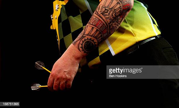 A detailed view of the tattoo of Simon Whitlock of Australia during his third round match against Dave Chisnall on day eleven of the 2013...
