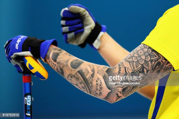 Detailed view of the tattoo on the arm of Sofia Mabergs of Sweden as she competes during the Women Curling round robin session 7 on day nine of the...