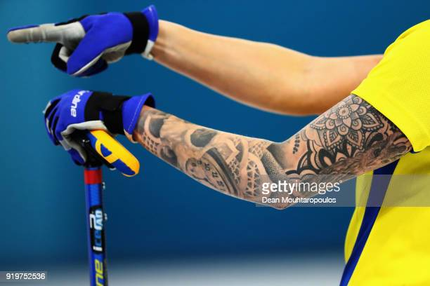 A detailed view of the tattoo on the arm of Sofia Mabergs of Sweden as she competes during the Women Curling round robin session 7 on day nine of the...