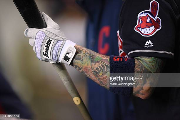 A detailed view of the tattoos and Franklin batting glove of Roberto Perez of the Cleveland Indians during the game against the Detroit Tigers at...