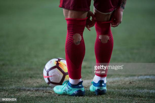 A detailed view of the torn socks of Ezequiel Lavezzi of Hebei China Fortune in action during the 2018 Chinese Super League match between Hebei China...