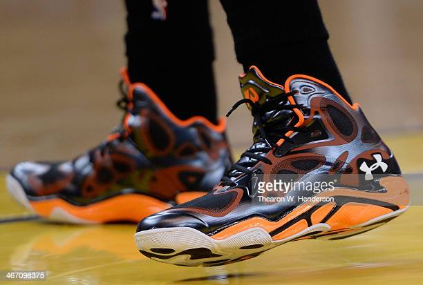A detailed view of the Under Armour basketball shoes worn by Kemba Waker of the Charlotte Bobcats against the Golden State Warriors at ORACLE Arena...